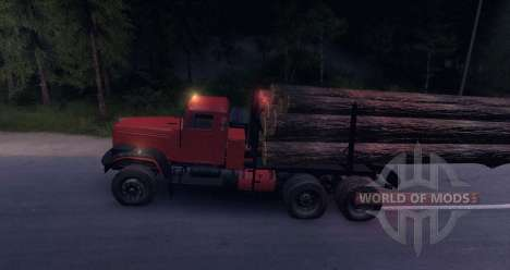 En la carretera de camiones KrAZ madera para Spin Tires