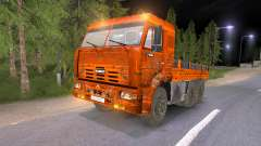 KAMAZ-65117 fangoso-naranja