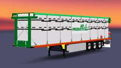 El semirremolque de plataforma con una carga de